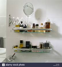 Retractable Mirror Bathroom Up Of Retractable Mirror Above Toiletry Bottles On Glass And