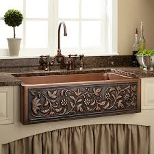 copper kitchen sink with flower vase and glass window also spoon