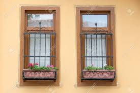 Old Fashioned House Turkish Old Fashioned House Windows With Black Bars And Geraniums