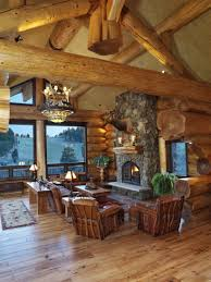 saddle notch ranch log great room with stone fireplace near