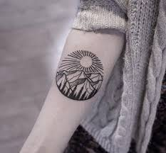 awesome mountain and sun on forearm