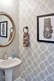 bathroom stencil ideas a diy silver and gray stenciled accent wall in a bathroom using