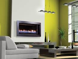 modern gas fireplace logs blue painted on the wall brown rattan