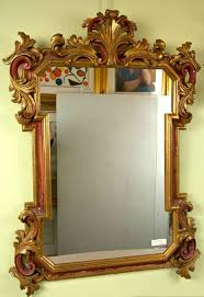 gilt gold and paint decorated hollywood regency style mirror for