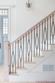 winding staircase is fitted with an iron handrail and iron