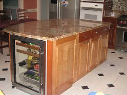 handmade kitchen island with winecooler and granite countertop by