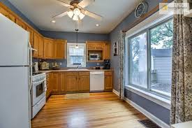 are wood kitchen cabinets outdated how could i upgrade this outdated country kitchen
