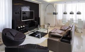 stylish living apartment with gray sofa and black swivels also