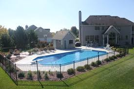 grecian with pool house fire pit in muskego apsp winner garden