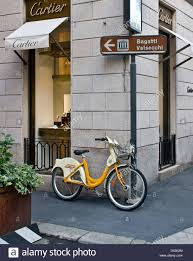 bike mi rental bicycle outside cartier designer luxury watch store