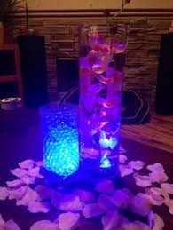 Water Bead Centerpieces by Teal And Clear Water Beads In Tall Cylinders W White Callas