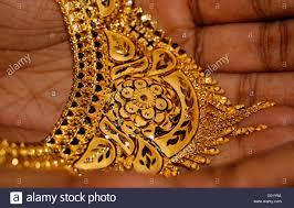 designed golden necklace jewellery on bridal gold design