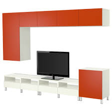 orange and white wooden cabinets and table with wall mounted