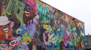 peerings hearings anomaly medium east wall mural on makerlab building painted by nelson garcia and xochitl leal photo jami macarty
