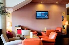 Tv And Lounge Area Picture Of Novotel Roissy Book Novotel Suites Roissy Cdg In Roissy En Hotels Com