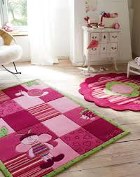 bedroom cute kids room decoration with pink rugs on the beige