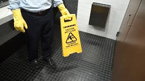 Wet Floor Images by Caution Wet Floor Sign Being Put Down In Washroom Stock