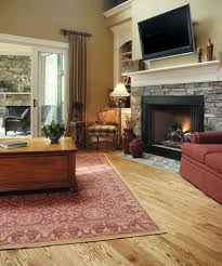 this romantic fireplace mimics the classic stone mantle it stands tall beneath a flat screen