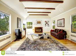 Cathedral Ceiling Living Room Ideas by Vaulted Ceiling With Brown Beams In Living Room Stock Photo
