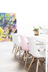 white molded eames shell chairs via citysage dining room design