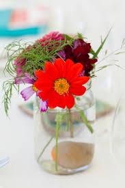 vivid wildflowers in mason jar wedding centerpieces kyo