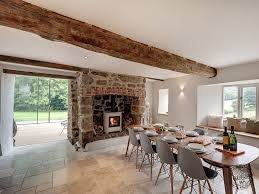 dining room interior with old oak floor beam ceiling