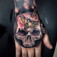 hand tattoos for guys skull death u0027s head hawkmoth and clock face on guys hand by