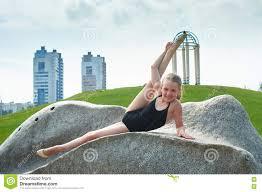 pretee models young beautiful preteen girl doing gymnastics outdoors stock photo