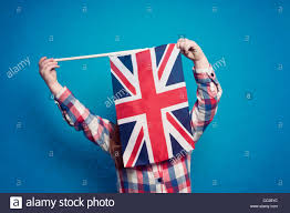 a young holding a british flag stock photo royalty free