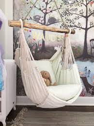 nice little nook for a kids room although it could become a nice this hammock chair and woodland wall mural wallpaper are wonderful design ideas for a baby nursery kid s room or playroom unique nursery and children s