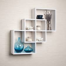 floating shelves ideas with white color shelves and blue vas and