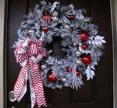 silver wreath with white fabric ribbon and