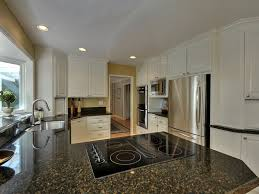 Selling Used Kitchen Cabinets by Dark Granite With Cream Cabinets