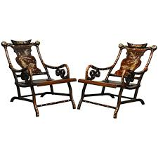 pair of chinese rosewood lounge chairs with mother of pearl inlay