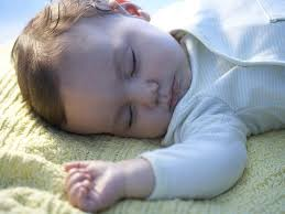 Baby Sleeping In A Crib by How Can I Get My Baby To Sleep Through The Night Babycentre Uk