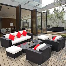 exterior black cape may wicker with blue cushions and concrete