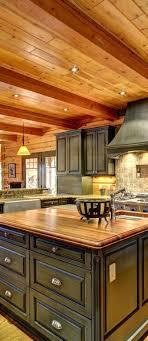 black kitchen cabinets in log cabin log home kitchen true log homes log home kitchens
