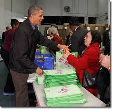 president obama and family volunteer at capital area food bank