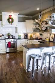 white kitchen wood floors this is it white cabinets subway tile quartz countertops