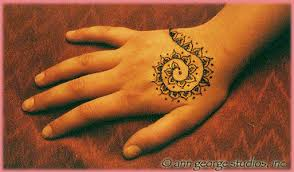 henna spiral tattoo on hand