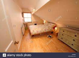 modern loft conversion bedroom stock photo royalty free image