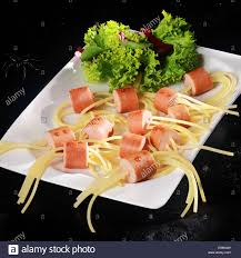 halloween spider background dog wiener and noodle halloween spider snacks with lettuce