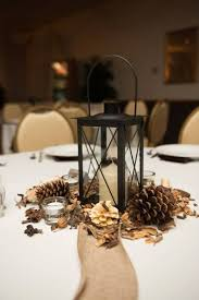 25 budget friendly rustic winter pinecone wedding ideas candle