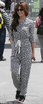 skin jumpsuit cheryl cole reaches heights in a leopard skin print jumpsuit