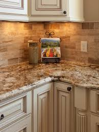 granite countertop kitchen with off white cabinets backsplash