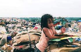 Urban poor in the Philippines living in dump sites  including this little girl
