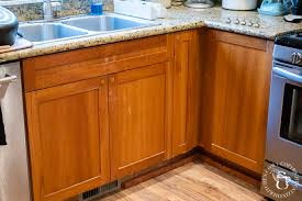 painting kitchen cabinets wood color diy painting our kitchen cabinets with white milk paint
