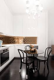 Copper Kitchen Backsplash Ideas Copper Kitchen Backsplash Small Rounded Island With Black Chair