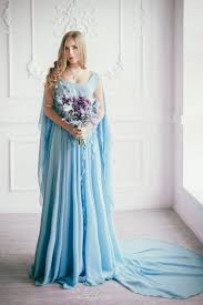 teal wedding dresses picture of flowy and airy blue wedding dress with a and a cape