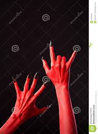 halloween background long red devil hands with long black nails real body art royalty free